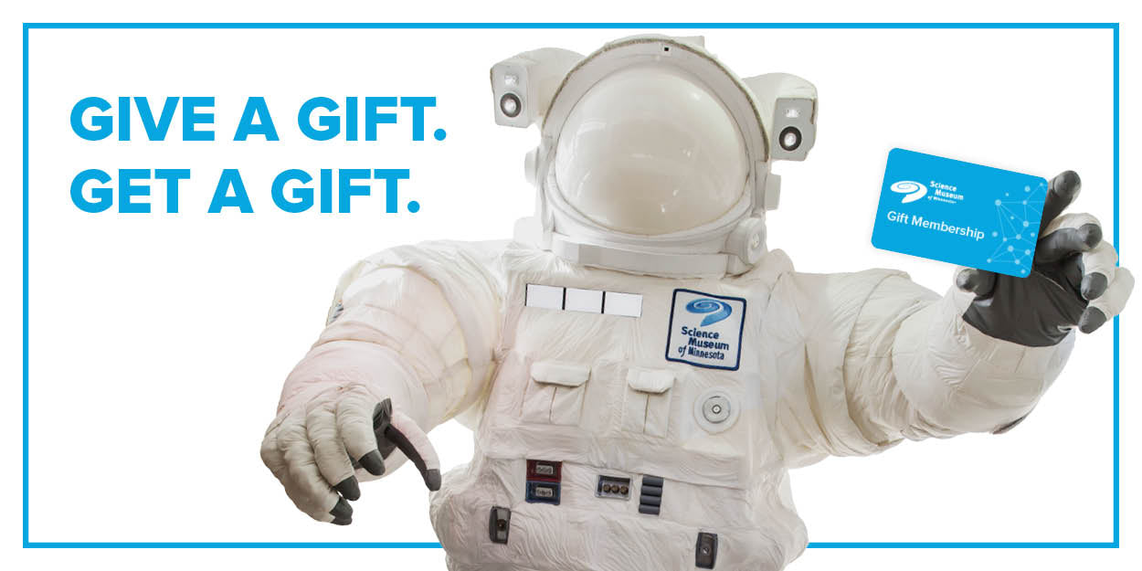 Giant astronaut holding a gift membership gift card