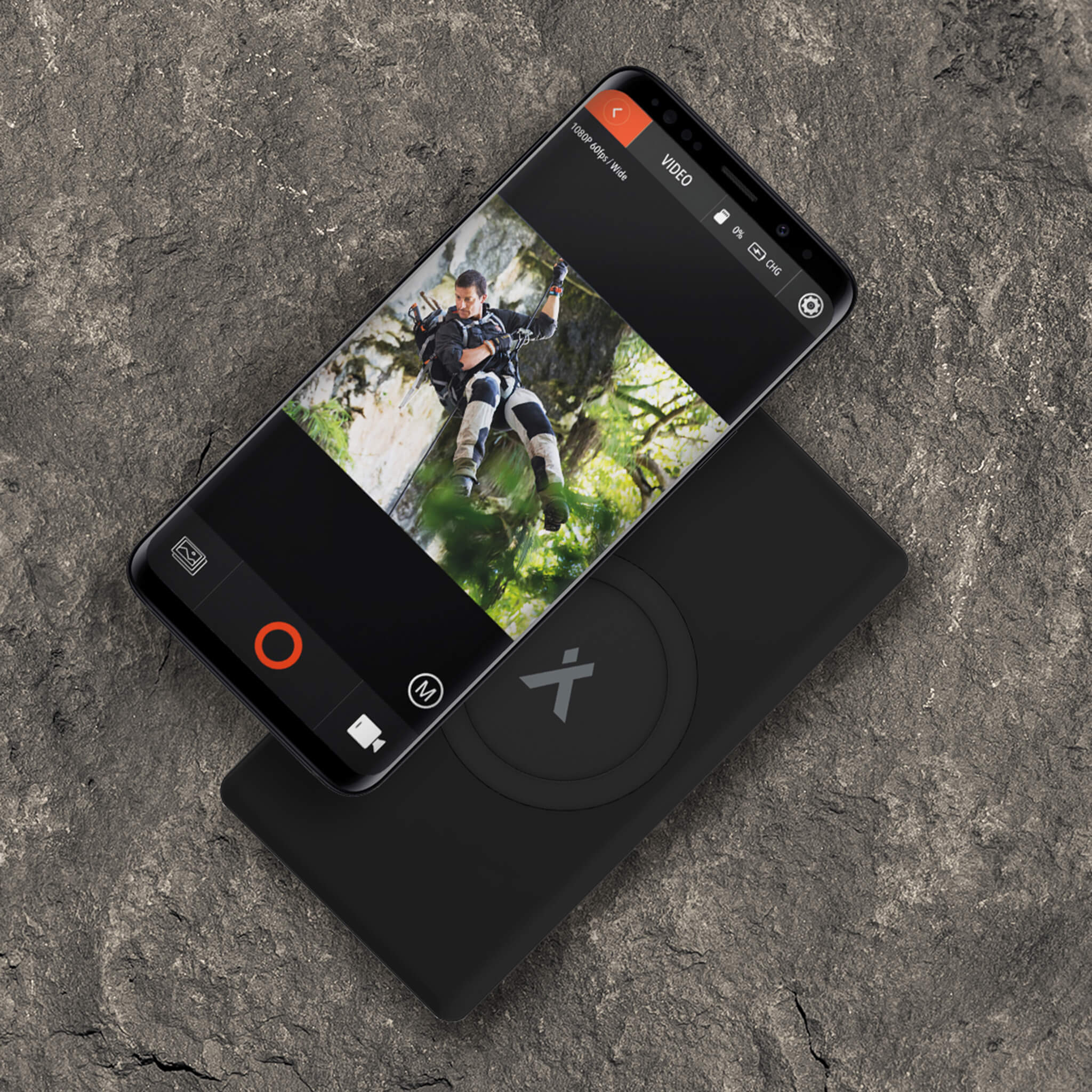 Bear Grylls power bank charging a mobile phone