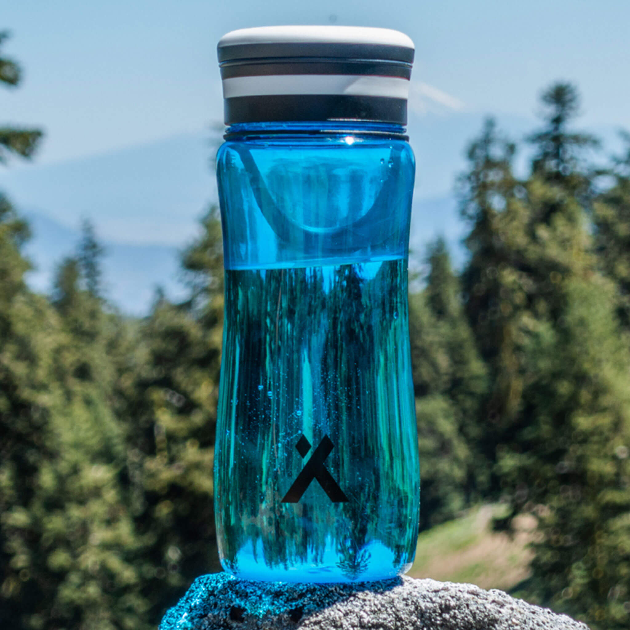Bear Grylls Solar Bottle against bright blue sky