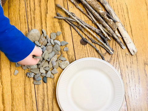 Campfire craft for kids with rocks, sticks and paper plate