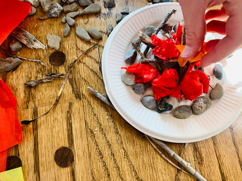 Campfire craft for kids with rocks, sticks, coloured tissue paper and paper plate