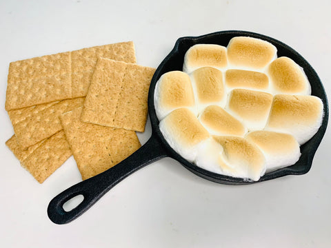 S'mores marshmallows in cast iron pan with graham crackers