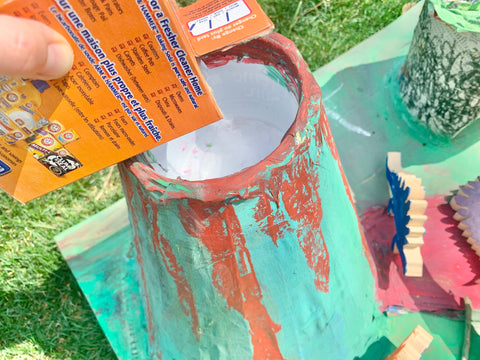 baking soda pouring into volcano craft experiment
