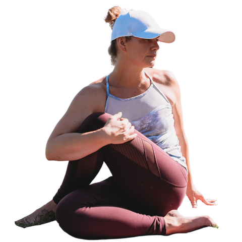 Women in half lord of the flies yoga pose, wearing a womens white Ponyback ponytail hat