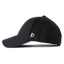 Load image into Gallery viewer, Side view of a black Ponyback ponytail hat that showcases the Ponyback logo in white embroidery.