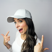 Load image into Gallery viewer, Woman wearing the Ponyback grey ponytail hat, this woman has her hair down not using the closeable opening in the back.