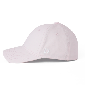 This is a side view of the women's Ponyback primrose pink ponytail hat.