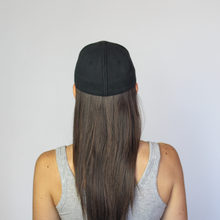 Load image into Gallery viewer, Back view of women wearing Ponyback ponytail hat in black in closed position with hair down