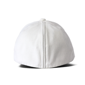 Back view of a white Ponyback ponytail hat with the back in closed position