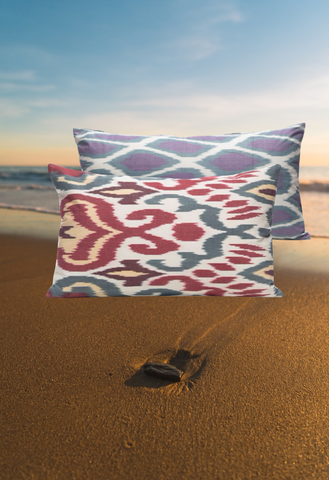 The sand and our Purple Back Citrus Blood Orange Ikat Cushion