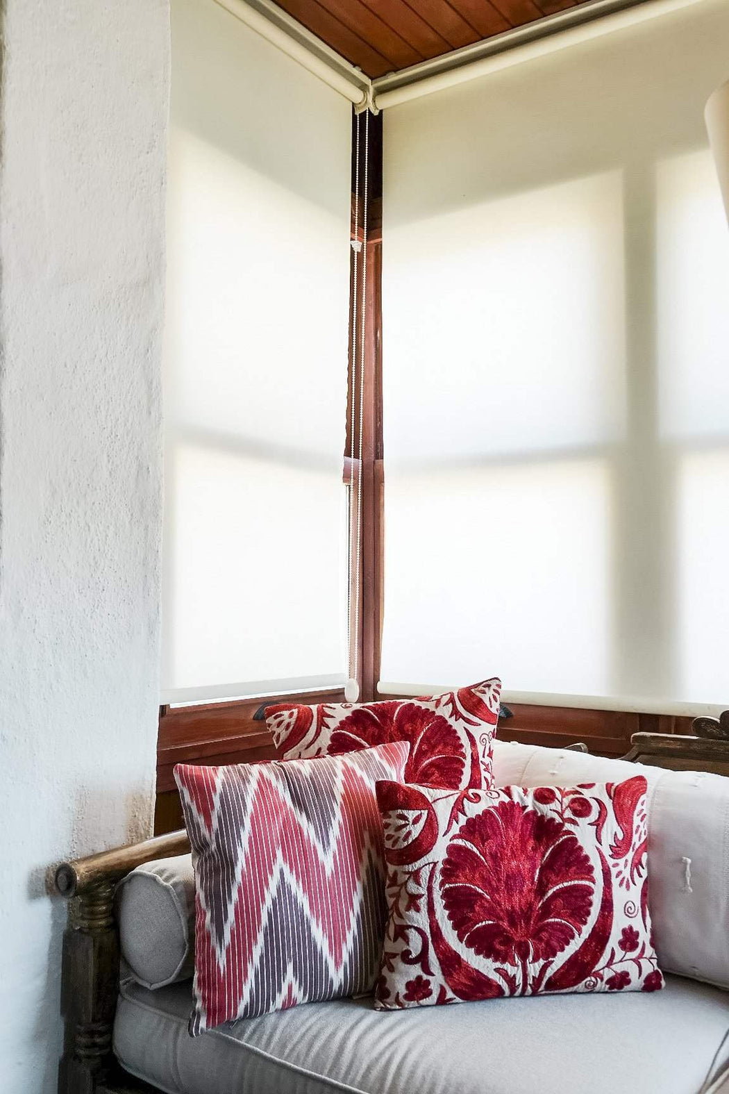 styled red suzani cushions