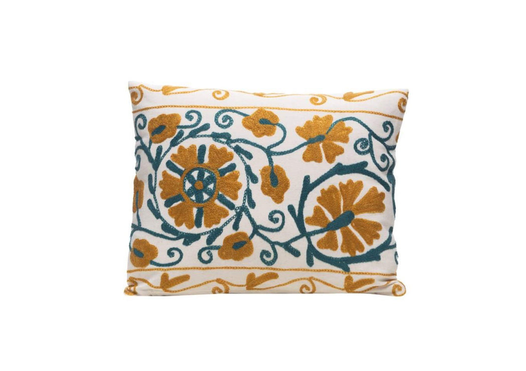 green and yellow embroidered cushion