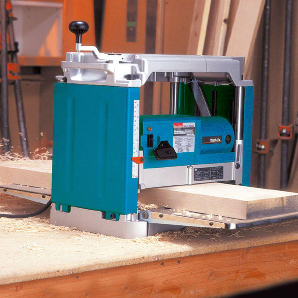 Makita 2012NB 12 In Planer with Interna-Lok Automated Head Clamp