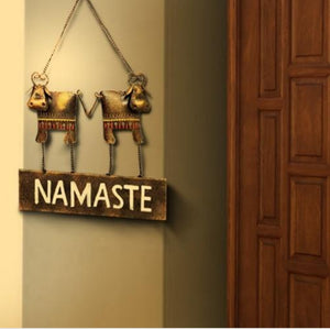 Handcrafted cow namaste hanging wall decor