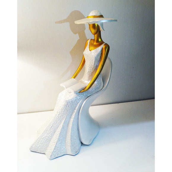 Lady studying polyresin gift showpiece
