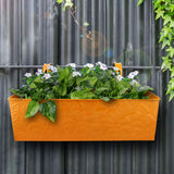 Large yellow metal balcony planter