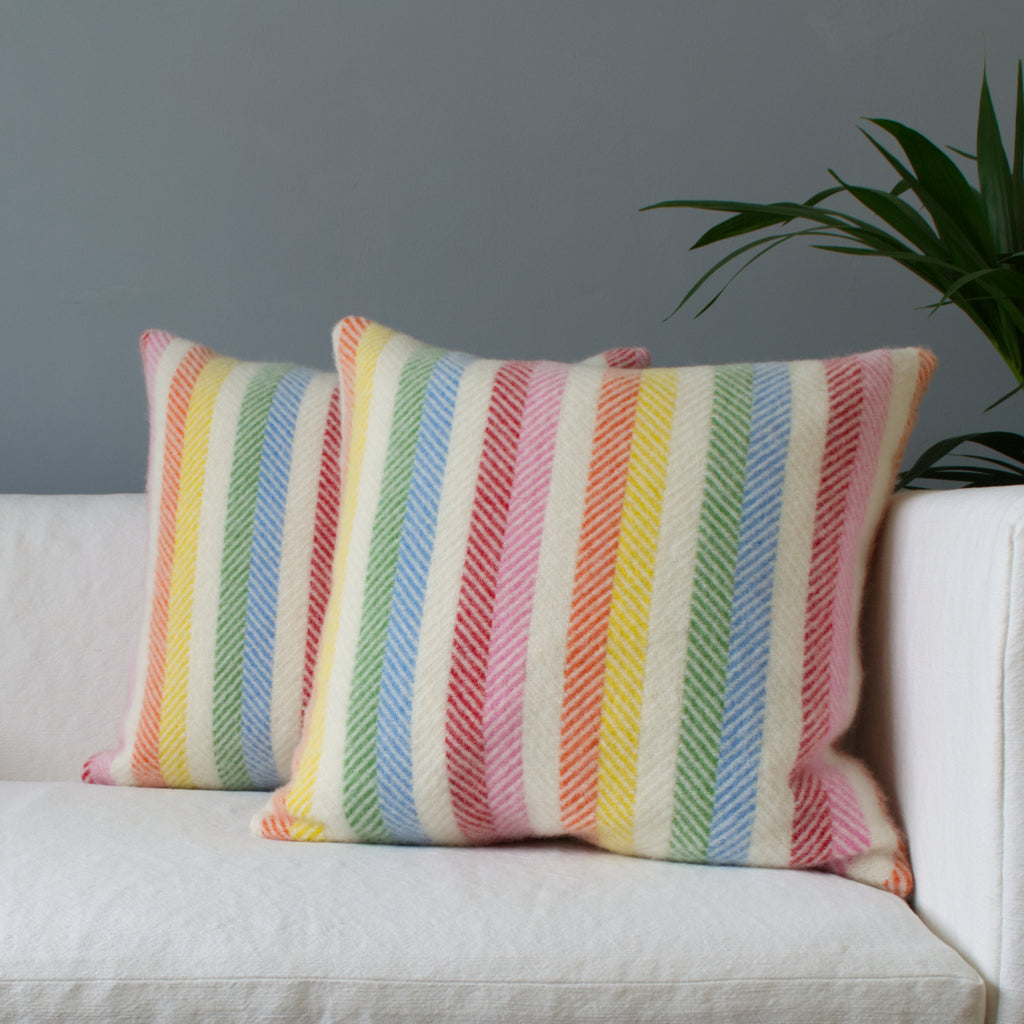 Pair of wool cushions with rainbow coloure stripes
