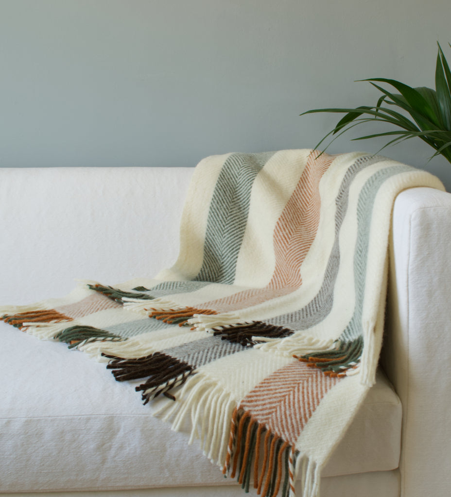 Tweedmill woodland stripe blanket throw over sofa