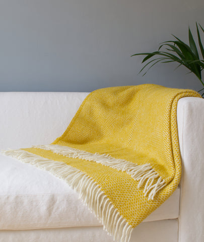 Beehive Yellow Wool Blanket Throw on Sofa