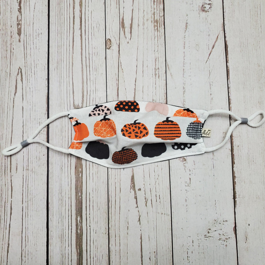 Child Kid Face Mask - Orange and Black Pumpkins - removable nose pc, adjustable ears