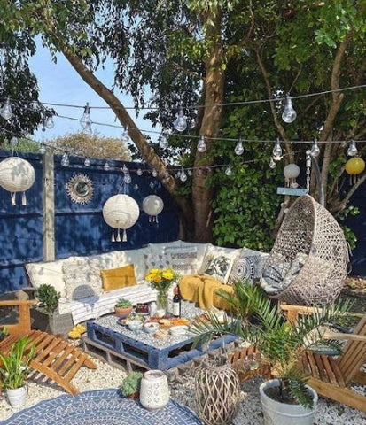 bright garden with seating and fairy lights