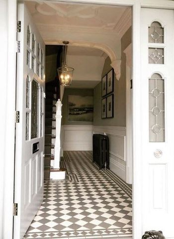 edwardian entrance to home with checked flooring