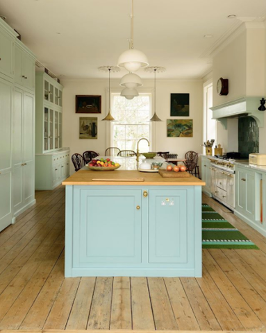 green kitchen with pendant lighting