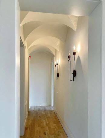 long white hallway with wall lights