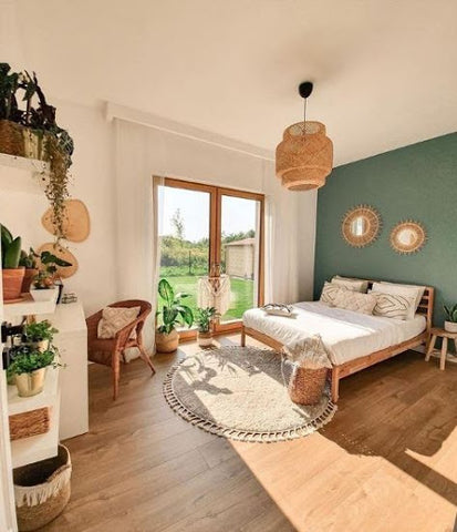 master bedroom with green wall and pendant light
