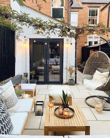 natural cosy outdoor space with seating and hanging lanters