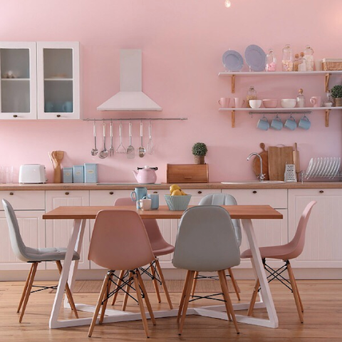 Pink kitchen design with copper lighting