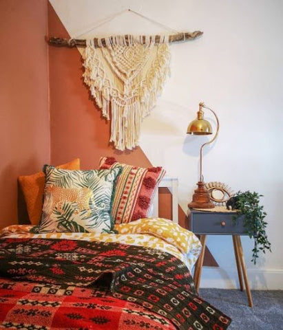 rustic red bedroom with table lamp for reading