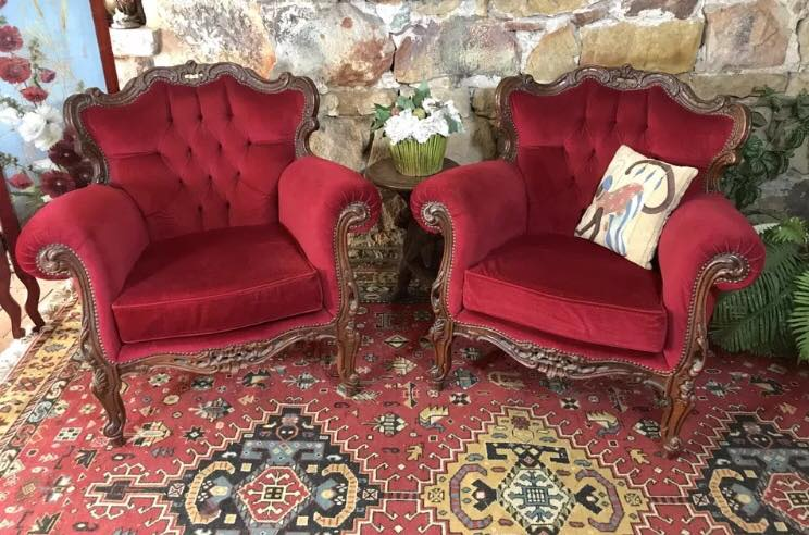 Red Chesterfield arm chairs