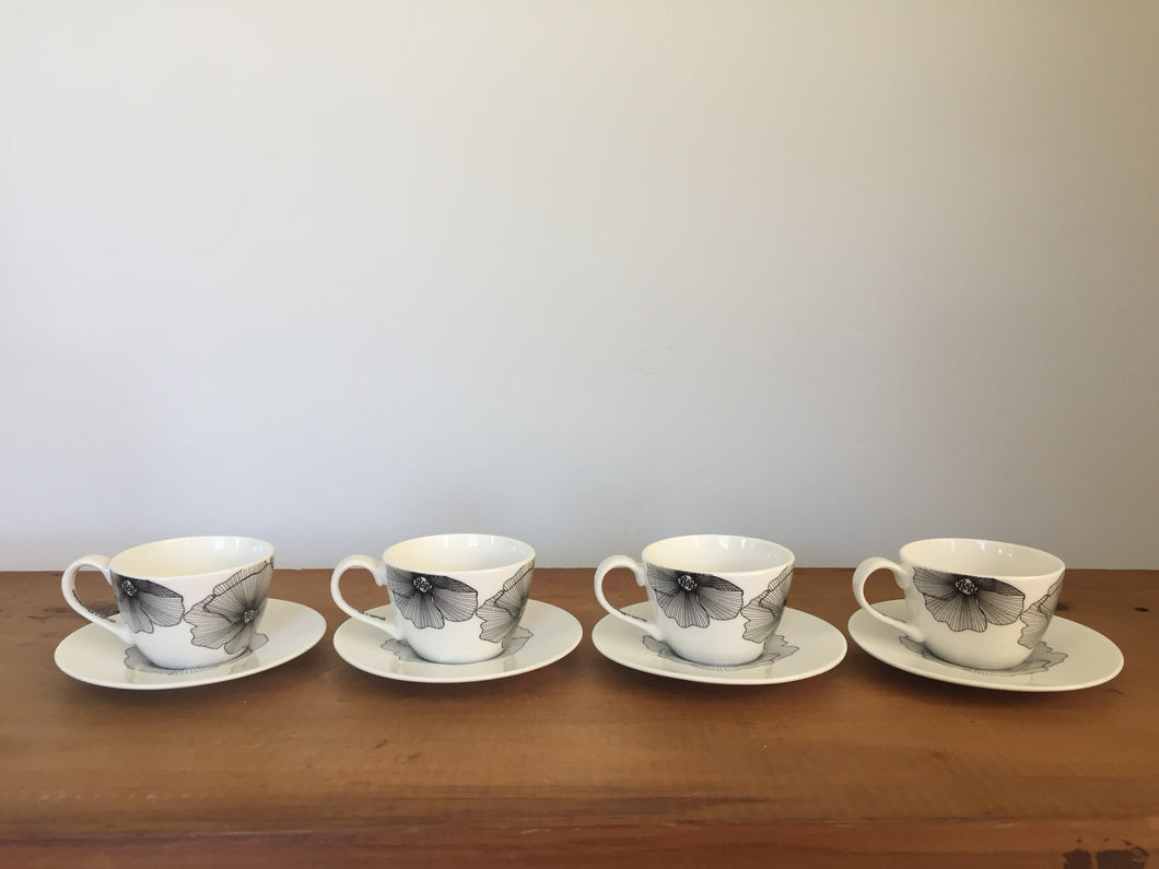 Black and white tea cups and saucers