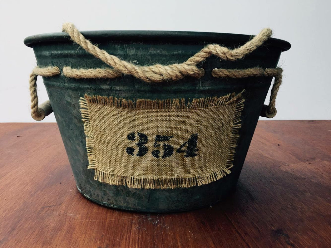 Metal tub with 354 hessian label