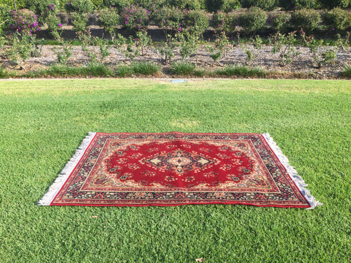Red rug with fringe - 120cm x 165cm