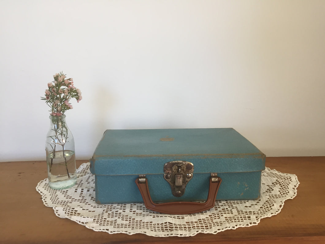Small blue suitcase