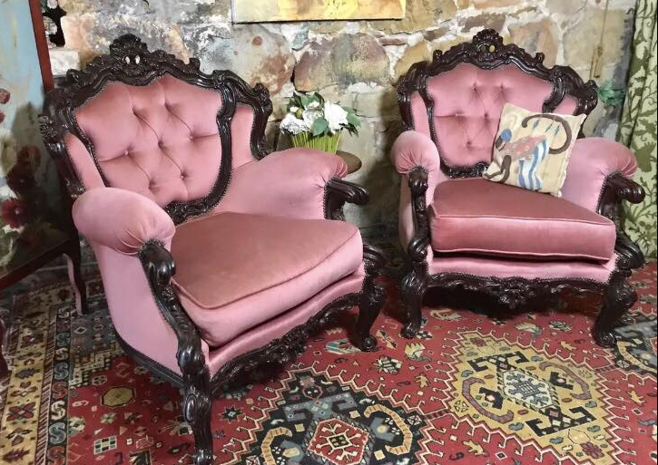 Pink Chesterfield arm chairs