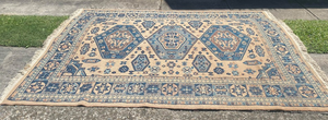 Blue and beige rug