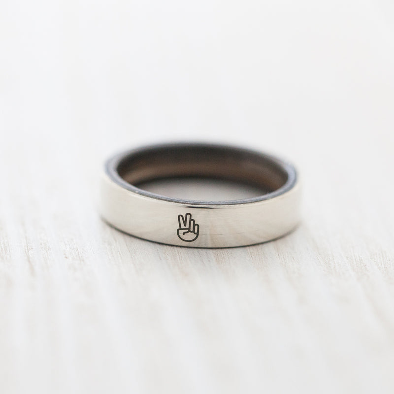 Peace engraving on silver & wood skateboard ring - BoardThing