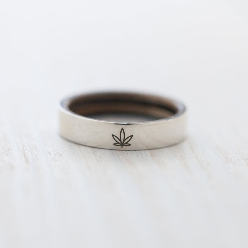 Ganja leaf engraving on silver & wood skateboard ring - BoardThing