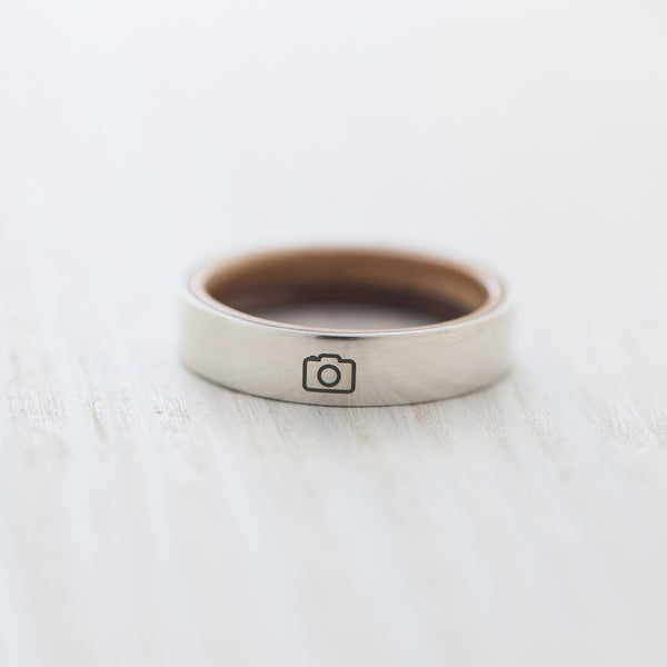 Camera engraving on silver & wooden skateboard ring - BoardThing