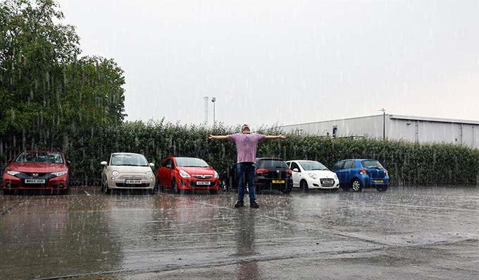 Louis our Warehouseman enjoying the much needed rain