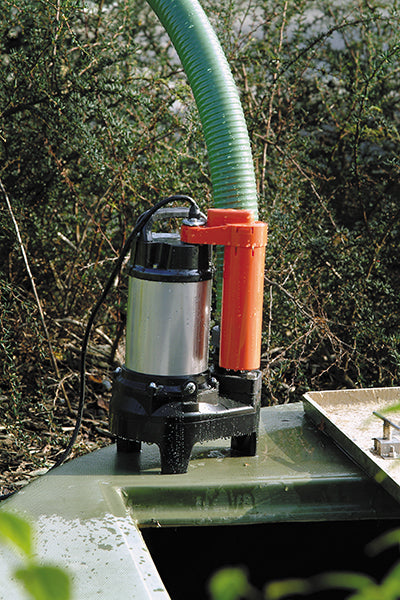 POMA Submersible Drainage Water Pump - location shot, pump extracting water through attachable hose