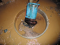 KRS Tsurumi Project Dewatering Pump in location shot, submerged in muddy water