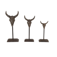 Textured Iron Bull Skull Sculptures on Stands