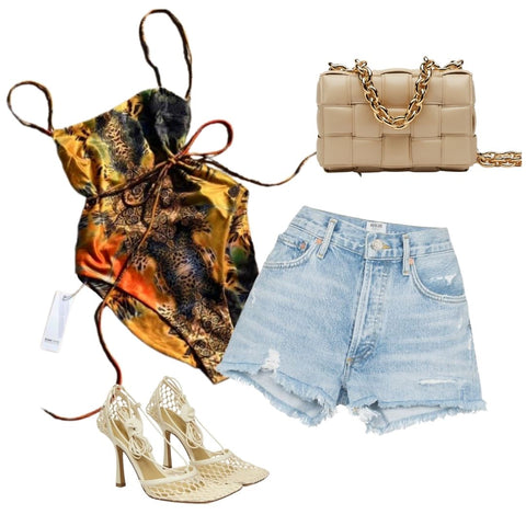 The Talia Cross Back One Piece Bodysuit in Safari Print paired with blue denim shorts, nude fishnet heels and a nude clutch bag
