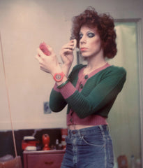 "NAN GOLDIN ""KENNY PUTTING ON MAKE-UP, BOSTON 1973"""