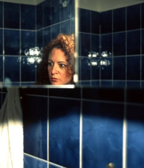 "NAN GOLDIN ""SELF PORTRAIT IN MY BLUE BATHROOM, BERLIN 1991"""