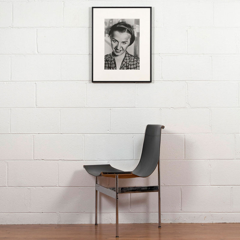 Cindy Sherman, Untitled, Photograph, 1975, Caviar 20, shown displayed in frame on white brick wall with Eames chair